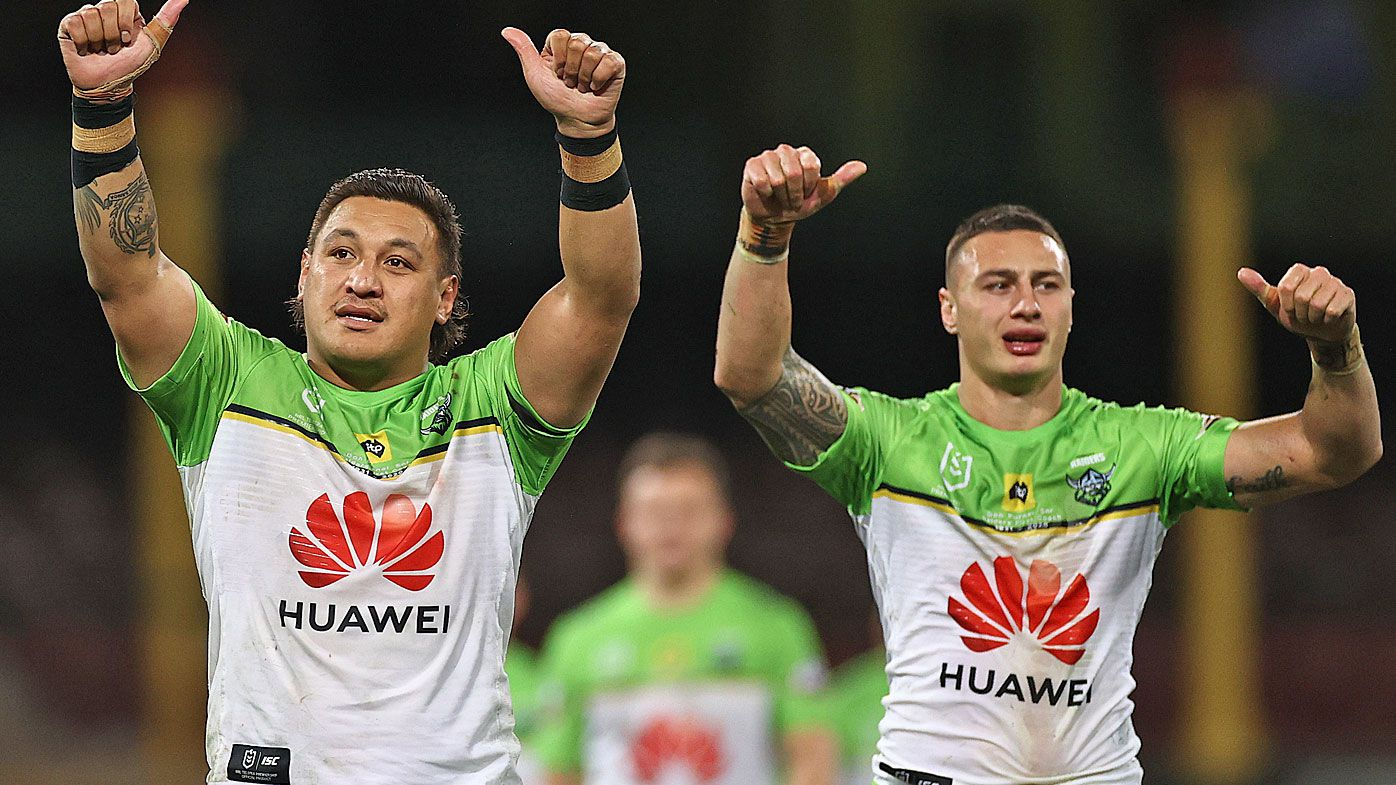 Josh Papalii and Charnze Nicoll-Klokstad wave to fans after the Raiders defeated the Roosters