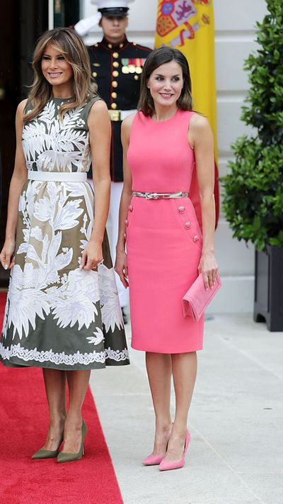 <p>In June 2018, Queen Letizia put her sartorial stamp on the White House lawn in a hot pink Michael Kors midi dress with a thin metallic belt. While Melania's clothing budget extends to $70,000 Dolce & Gabbana coats, Letizia's designer dress was priced at a more reasonable $2,299.<br /> <br /> </p>