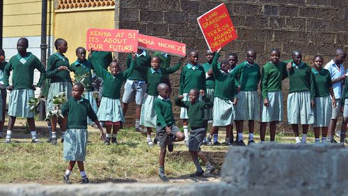 Schoolchildren in Nairobi protest after they broke a wall erected around their playground. (Getty Images)