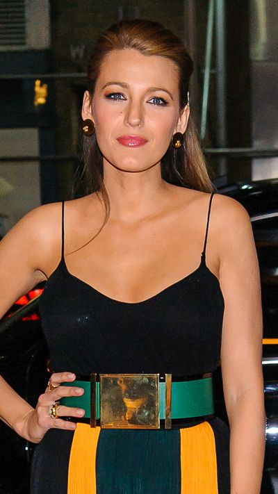 Blake pulls the front of her hair back, letting her oversized earring and winged liner steal the show.