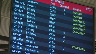 A departure and arrivals board at an airport reflects border closures across Australia, in reaction to the cluster outbreak at Sydney's Northern Beaches.