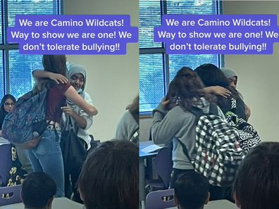 Young teenagers in school embracing and hugging in a classroom.