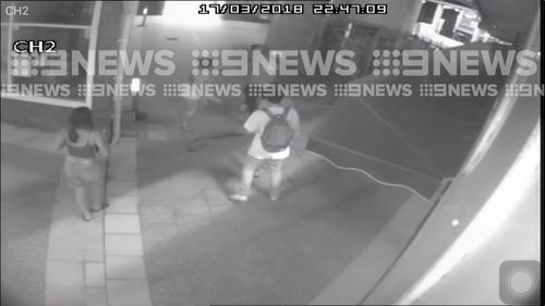 The exclusive vision shows a group of people, both men and women, arguing at Panania station just before 11pm yesterday. (9NEWS)