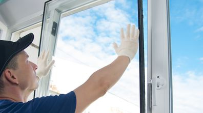 Man installing a double-glazed window