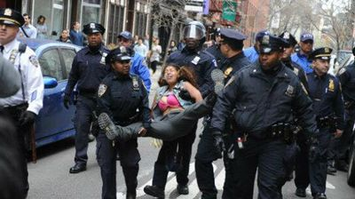 These police were moving this woman on, all 11 of them.