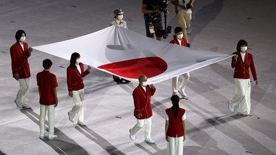 The Japanese emblem  enters the stadium