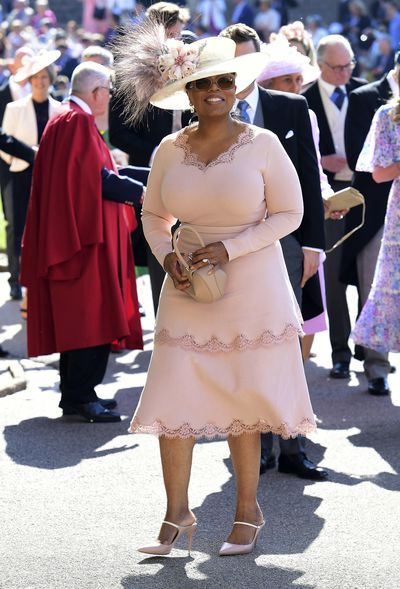 <strong>Photo of Oprah Winfrey</strong> in a blush dress and matching hat arriving at Meghan Markle and Prince Harry's wedding