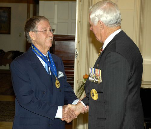Reg Grundy receives the Order of Australia Companion in the General Division from Governor-General Major General Michael Jeffery pose at Government House, Canberra in 2008 (AAP)