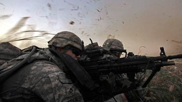 In this 2011 photo, US soldiers from 1st Battalion, 18th Infantry Regiment are bathed in rotor wash moments after arriving by Blackhawk helicopter in Iraq.