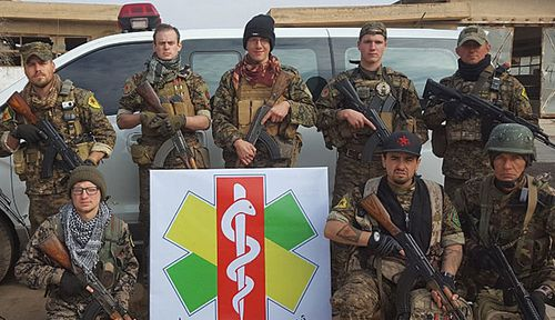 Lucas Chapman, (far left, front) and other international volunteers who joined the Kurdish militias. (Photo: Lucas Chapman).