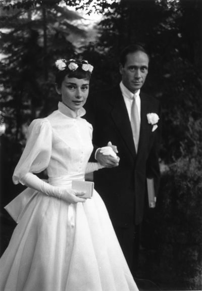 <p>Audrey Hepburn and Mel Ferrer, 1954</p> <p>Dress: Balmain</p> <p>Former dancer Audrey Hepburn showed off her slender arms in this fitted tea-length dress with a flared skirt and high collar.</p>