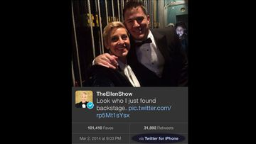 Ellen DeGeneres caught using her iPhone backstage despite flashing a Samsung for the camera's while taking selfies.