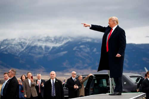 Trump arrives for a campaign rally at Bozeman Yellowstone International Airport in Belgrade, Montana.