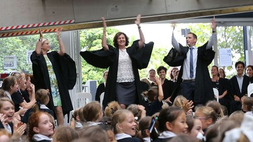 Susan Forbes (centre) performs the Borobi Boogie as she farewells St Margaret's Anglican Girls School. (Image: Supplied)