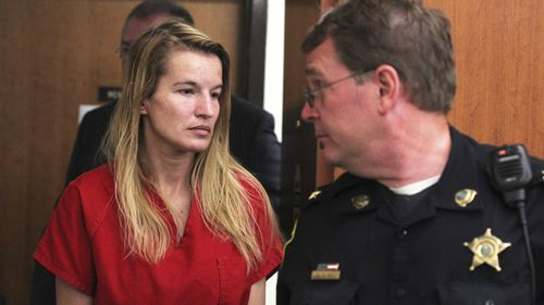 Jody Herring is led out of court after her 2015 arraignment in Vermont Superior Court. (AAP)