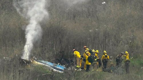 Firefighters and sheriffs work the scene of a helicopter crash that killed former NBA basketball player Kobe Bryant
