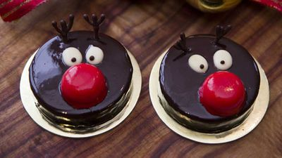 "Recipe: <a href=""https://kitchen.nine.com.au/2017/12/18/22/39/rudolph-the-red-nose-reindeer"" target=""_top"">The Grosvenor Hotel's Rudolph the red nose reindeer mousse cake</a>"