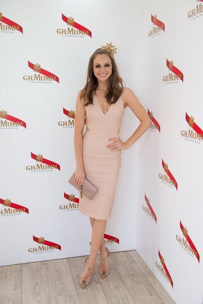 E! News host Ksenija Lukich in a Manning Cartell dress and a Viktoria Novak crown.