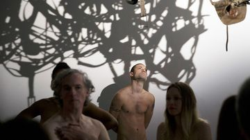 """The Palais du Tokyo museum opened its doors to an estimated 160 nudists for a """"special visit Saturday"""". (AP)"""