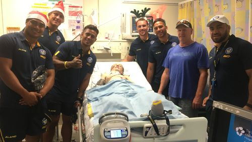 With a tight-knit community behind him, visits from a few of Louie's footy heroes have lifted his spirits. (Supplied)
