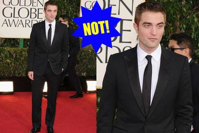 Nothing wrong with the suit, but could it really hurt to smile? And where's Kristen? Red-carpet let-down.