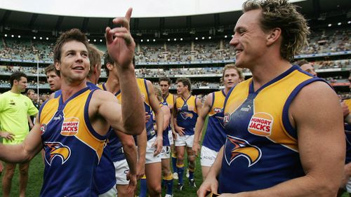 Daniel Chick with Ben Cousins after a win against Richmond in 2005. (Getty)