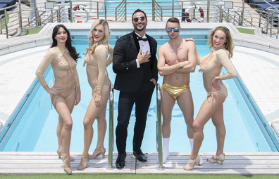 P&O Cruises entertainment line-up | Performers pose in front of a pool onboard P&O's Pacific Adventure