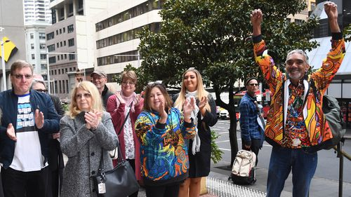 Supporters of Gary Jubelin, including Mark and Faye Leveson, applauded as the former detective arrived at court.