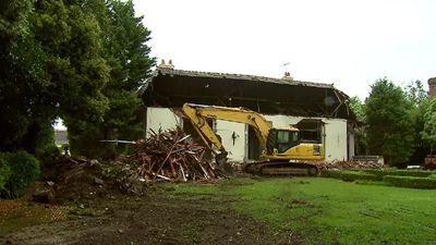 Demotion began today, with the front of the roof and the large windows already ripped out. (9NEWS)