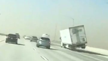 A large truck toppled on a highway during strong winds in Southern California.