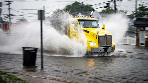 A truck makes its way through the flooding caused by Tropical Storm Elsa in New York.