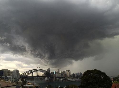 The sky turned from sunshine to darkness within a matter of minutes over the CBD. (@oknermin)