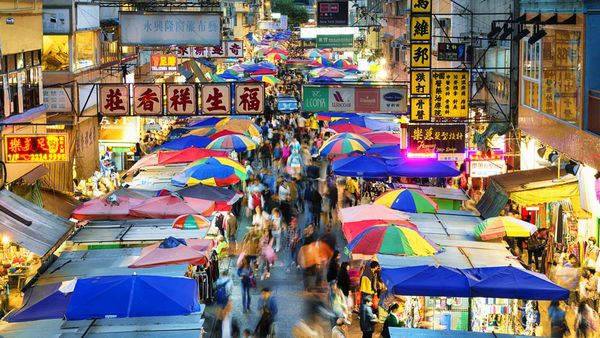 Colourful umbrellas line the streets at Hong Kong's wet markets