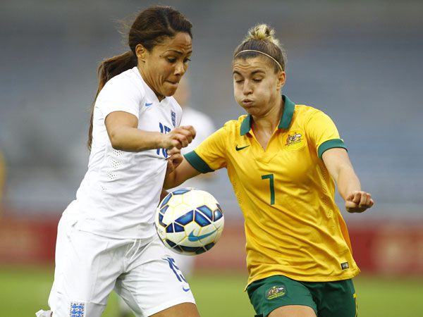 Australia's Stephanie Catley challenges England's Alex Scott for the ball. (Getty)