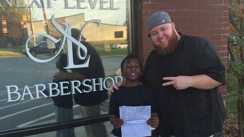 Kamarian Fox, 9, and barber Mike Shelton. (Social Media)
