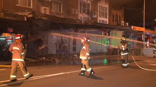 Firefighters at the scene of the fire. (9NEWS)