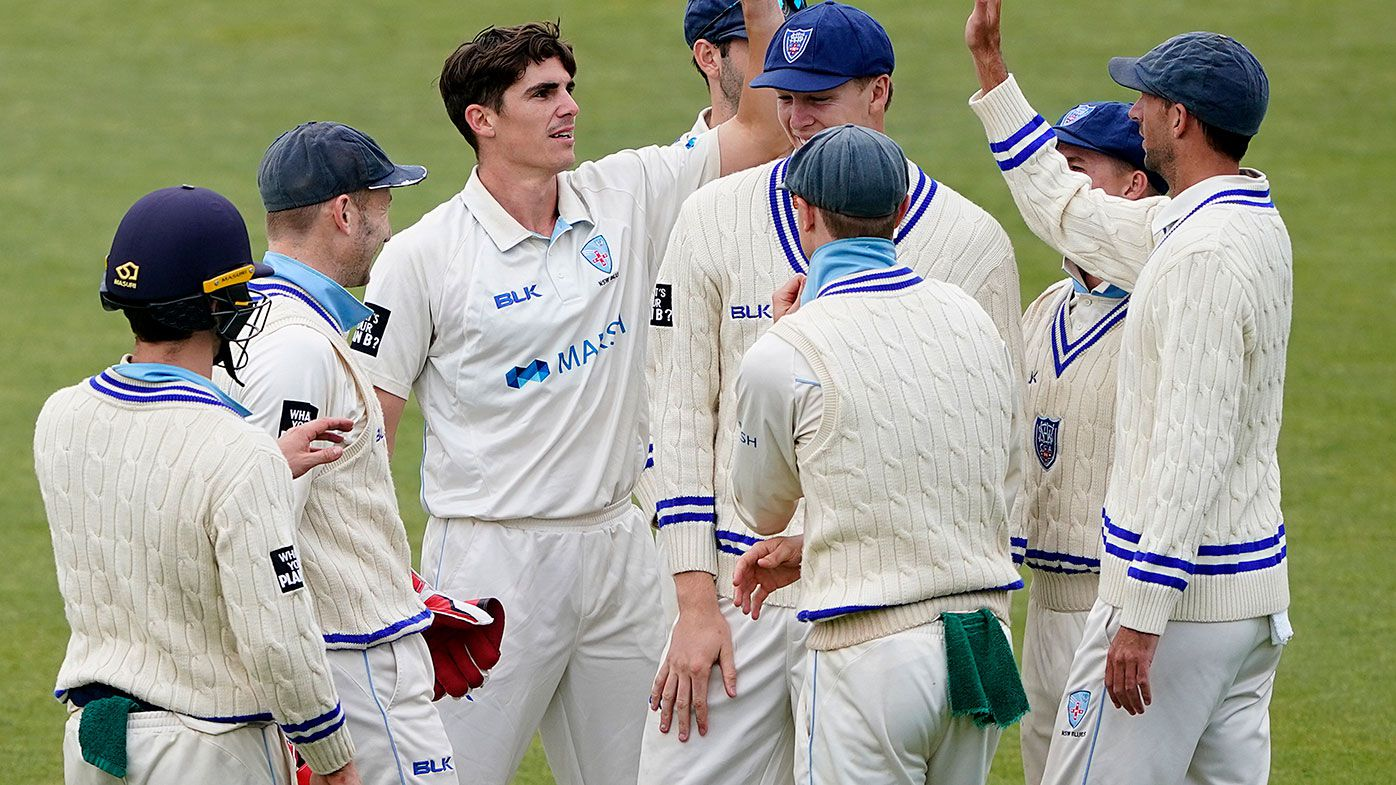 Sean Abbott celebrates a wicket for NSW.