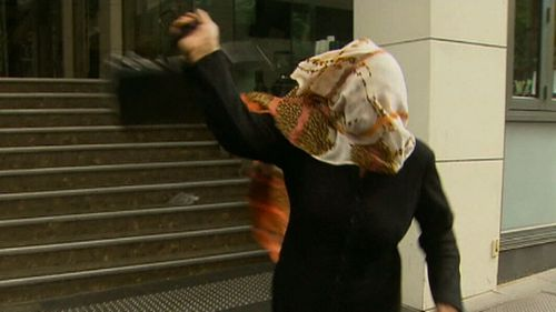 Mother of driver allegedly responsible for Thursday's horror arrives at court swinging her handbag. (9News)