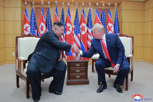 North Korean leader Kim Jong Un, left, and U.S. President Donald Trump shake hands inside the Freedom House on the southern side of Panmunjom, South Korea on June 30, 2019.