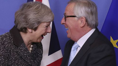 British Prime Minister Theresa May (L) and European commission President Jean-Claude Juncker (R) prior to a meeting in Brussels.