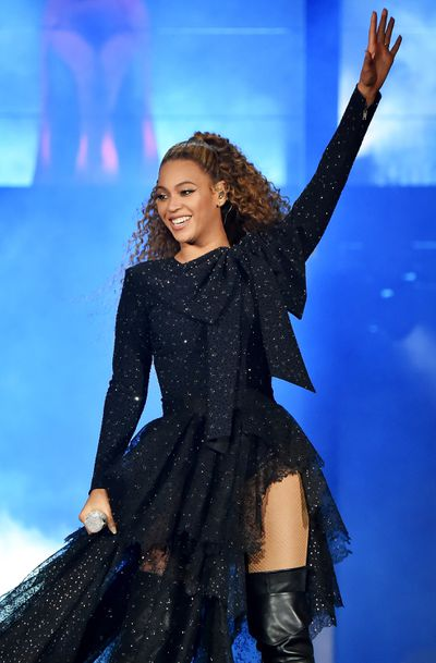 Beyoncé in a sparkling tulle dress and leather over-the-knee boots performing during her 'On The Run' tour.