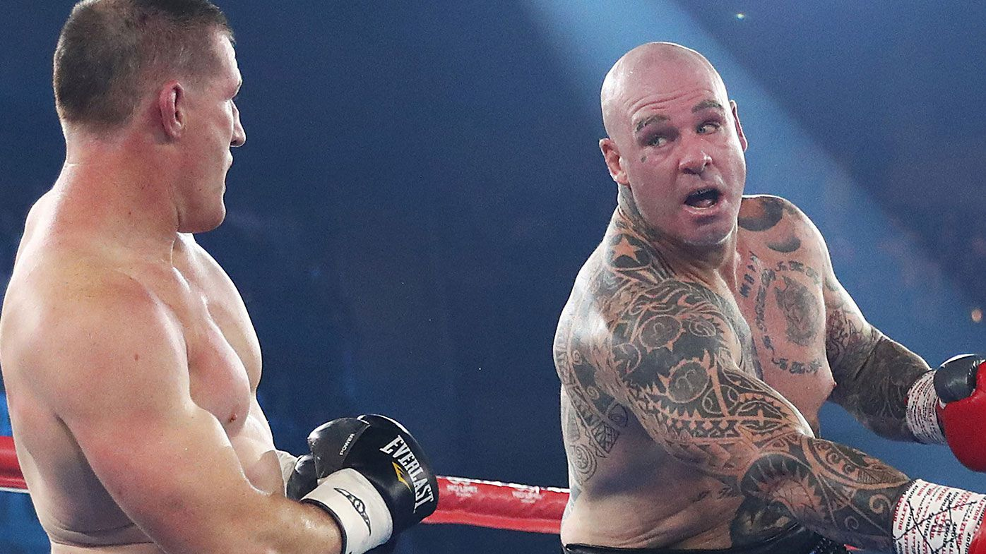 Lucas Browne swings at Paul Gallen during their bout at WIN Entertainment Centre on April 21, 2021 in Wollongong, Australia. (Photo by Mark Metcalfe/Getty Images)