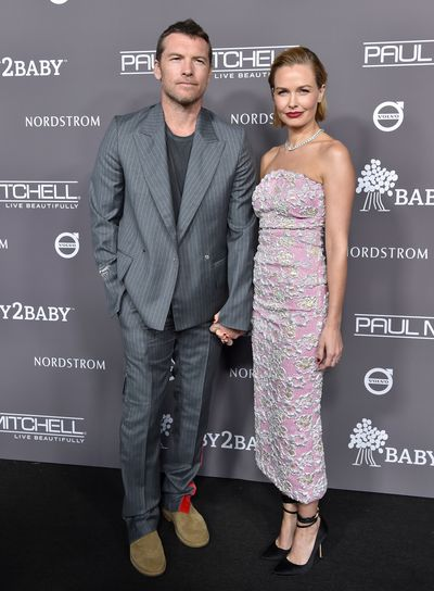 Sam and Lara Worthington, wearing Miu Miu, at the 2018 Baby2Baby Gala in Los Angeles, November, 2018
