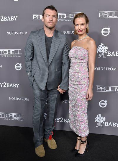 Sam and Lara Worthington, wearingMiu Miu, at the 2018 Baby2Baby Gala in Los Angeles, November, 2018