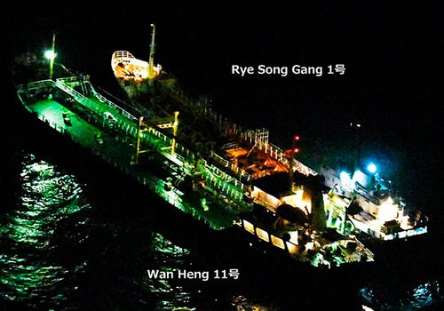 """An image released by Japan's Ministry of Defense shows what it says is the Belize-flagged tanker Wan Heng 11 next to the North Korean-flagged Rye Song Gang 1 in the East China Sea carrying out a suspected banned """"ship-to-ship"""" transfer. (AP)."""