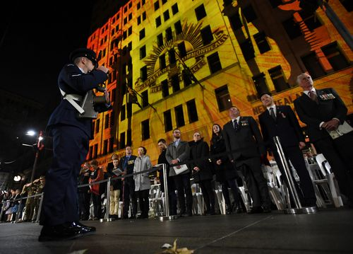 Buildings in Martin Place were lit up with pictures from conflicts Australians have been involved in. (AAP)