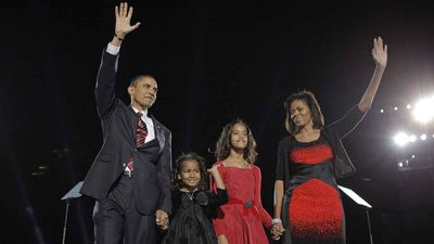 The Obama family take to the stage after Barack's historic election in 2008. Not only did Obama become the first black president, he won in a landslide in 2008. (AP)
