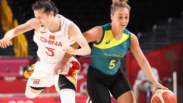 Leilani Mitchell of Team Australia drives past Siyu Wang of Team China at the Tokyo Olympics.