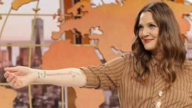 Drew Barrymore got a tattoo live on 'The Drew Barrymore Show'