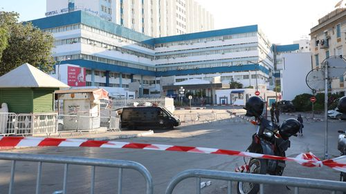 Security forces secured the entries of the military hospital where the Tunisian president died.